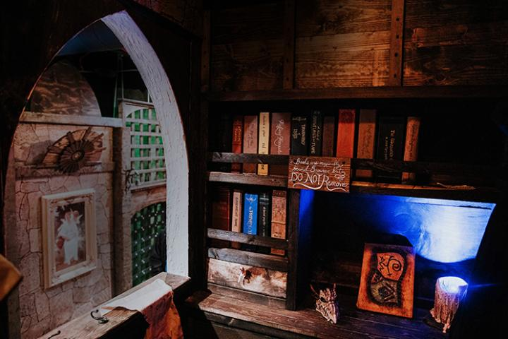 A shelf of books from the Wizards Library in our magical escape room!